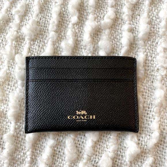 NWT! Black, faux leather Coach card holder.